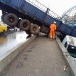 Many escape death as Truck falls off Oshodi Bridge in Lagos