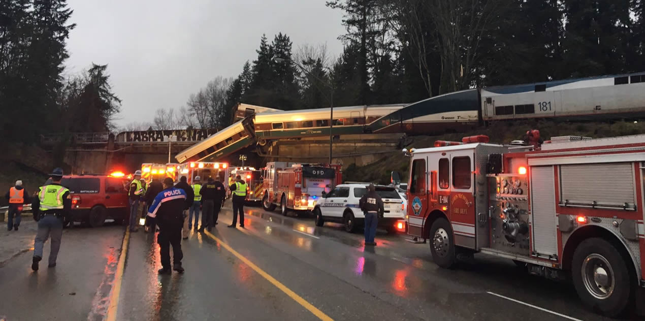 train-derails-over-washington-highway-injuries-many