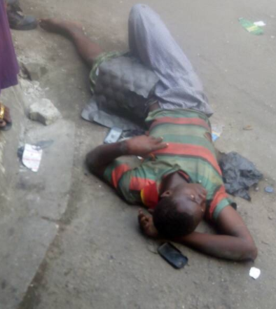 Hawker falls off the bridge after he is hit by a commercial bus in Lagos (photos)