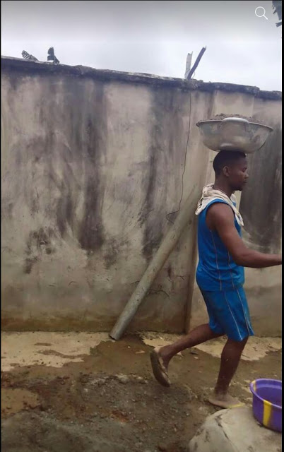 Photos of unemployed Nigerian graduate working as a bricklayer