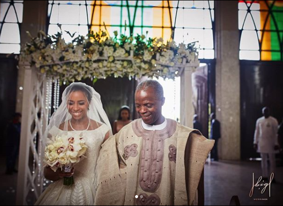 Lovely photos of VP Yemi Osinbajo walking his daughter down the aisle at her wedding in Abuja today