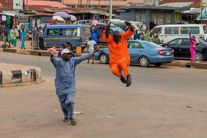 Photos of governor Aregbesola and the newly elected governor of Osun state Oyetola, celebrating on the streets after election