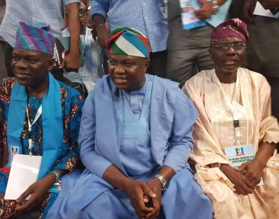 Photos: Governor Ambode and Babjide Sanwo-Olu all smiles as they meet at the APC convention in Abuja