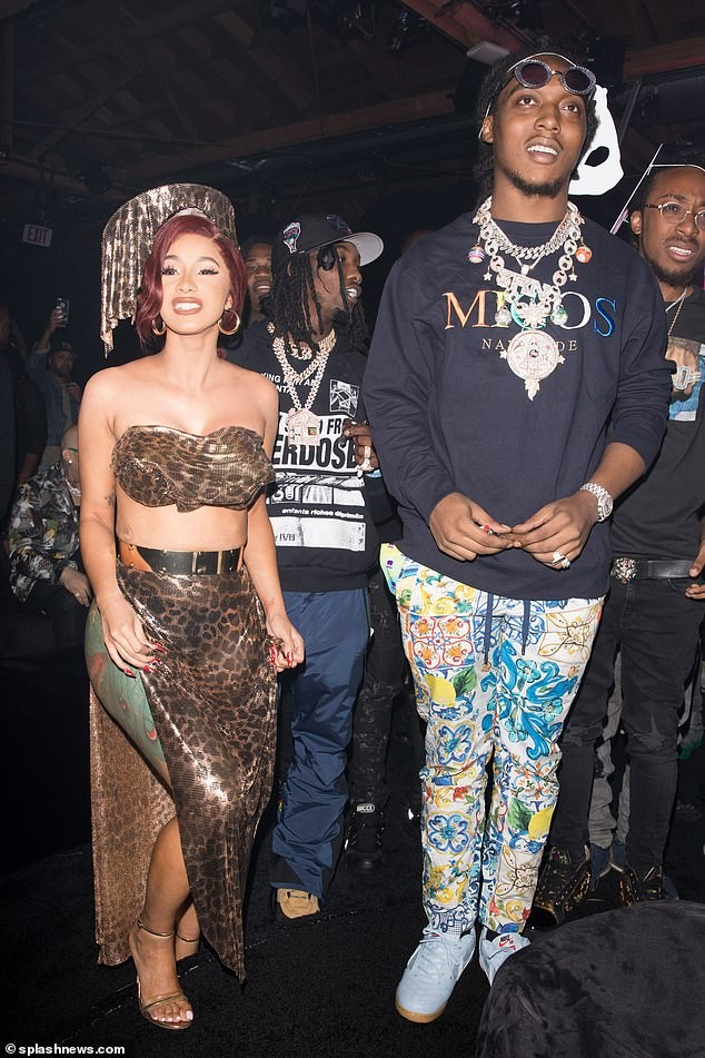 Cardi B rocks double split leopard print skirt as she seductively grinds on?husband Offset at her birthday night out (Photos)
