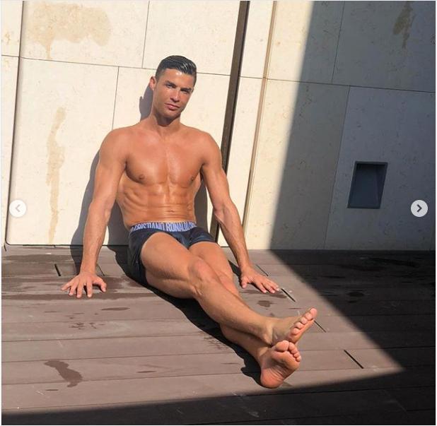 Cristiano Ronaldo flaunts his hot physique as he strips down to his briefs (Photos)