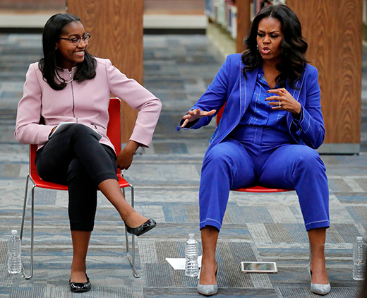 Michelle Obama tells Parisians 'now is the time to be strong'