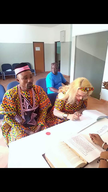 "Photos: Young African man thanks God for giving him a ""woman of honour"" as he weds white woman"