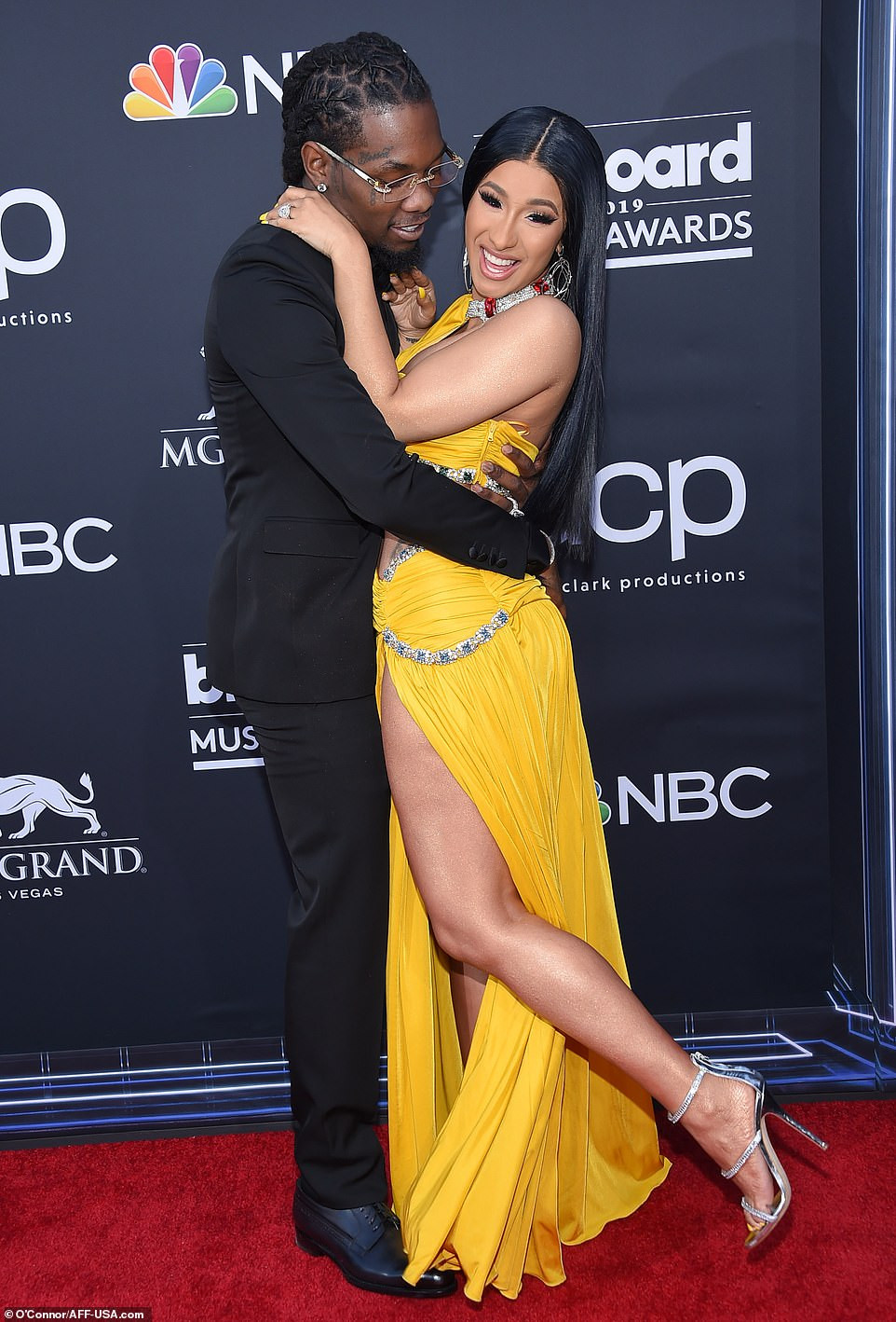 Cardi B nearly exposes her private part as lifts her leg while posing with?Offset at Billboard Awards (Photos)