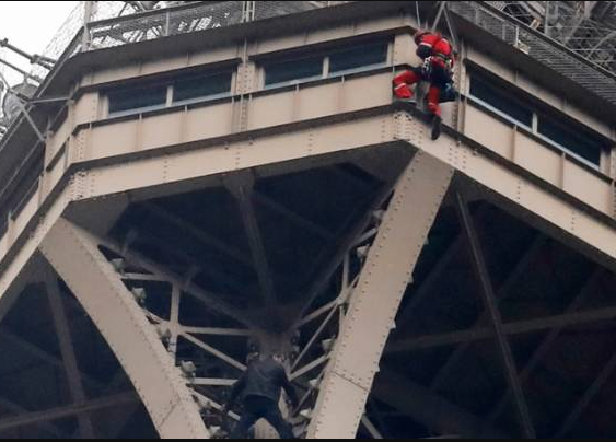 Eiffel Tower is evacuated and closed after man is spotted climbing up its side
