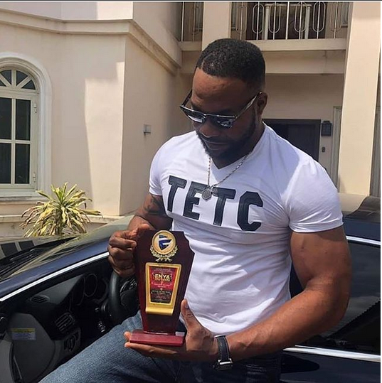 Bolanle Ninalowo show off one of his awards