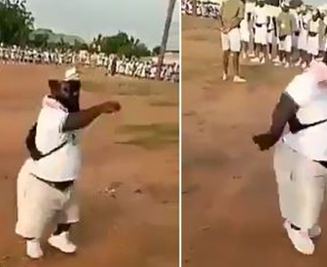 Dwarf Corper Leads Parade, Wows Other Corp Members (Video)