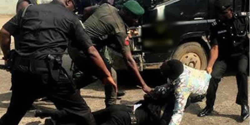 Nigerian Police officers during arrest