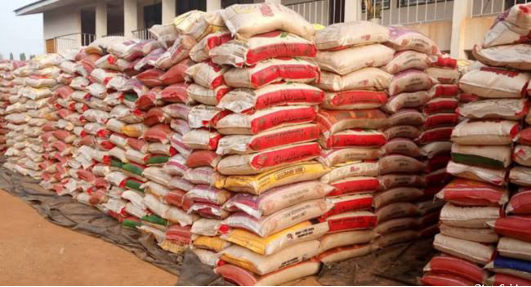 President Buhari orders distribution of 150 trucks of seized rice to Nigerians