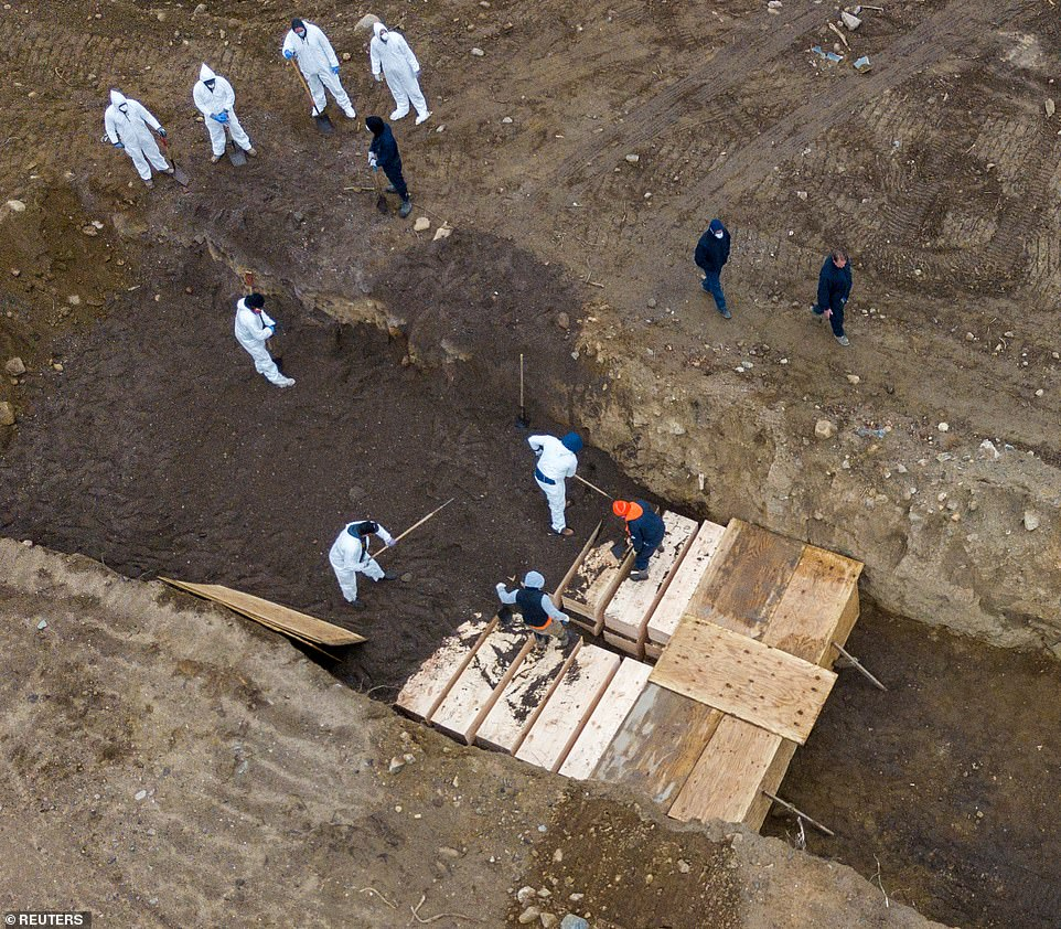 COVID-19: Hundreds of bodies buried in mass grave on island in New York