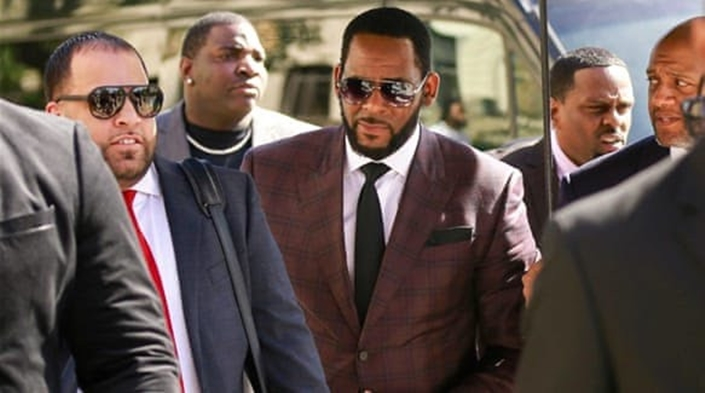 R.Kelly's friends charged for threatening women who accused the singer of sex crimes