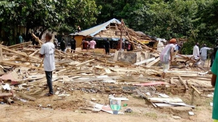 PHOTOS: FCT authorities demolish popular brothel as sex workers watch in agony