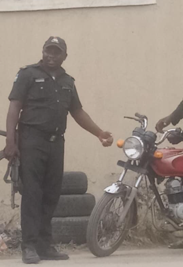 CP Odumosu orders trial of police officer pictured extorting money from a motorcyclist in Aguda