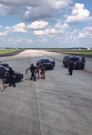 Half-naked man sprints toward Delta Air Lines plane at Atlanta airport after he jumped out of his plane and climbed onto the wing of another (video)