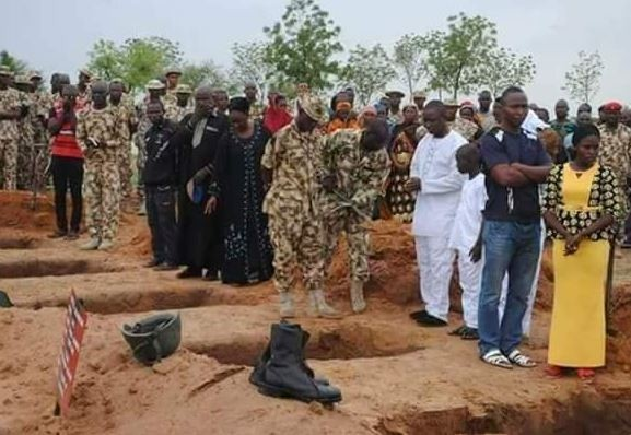 Photos from the mass?burial?of?Nigerian soldiers?killed by Boko Haram