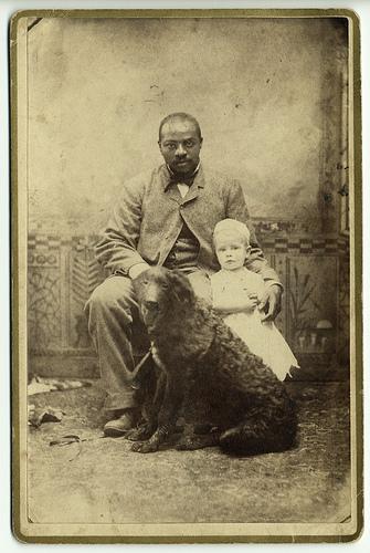 Blackmanwithwhitechildanddog